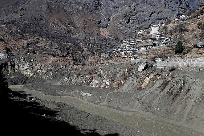 Mud and slash are seen in the Dhauliganga River after a portion of Nanda Devi glacier broke off in Tapovan area of the northern state of Uttarakhand, Sunday, Feb.7, 2021. (AP Photo)