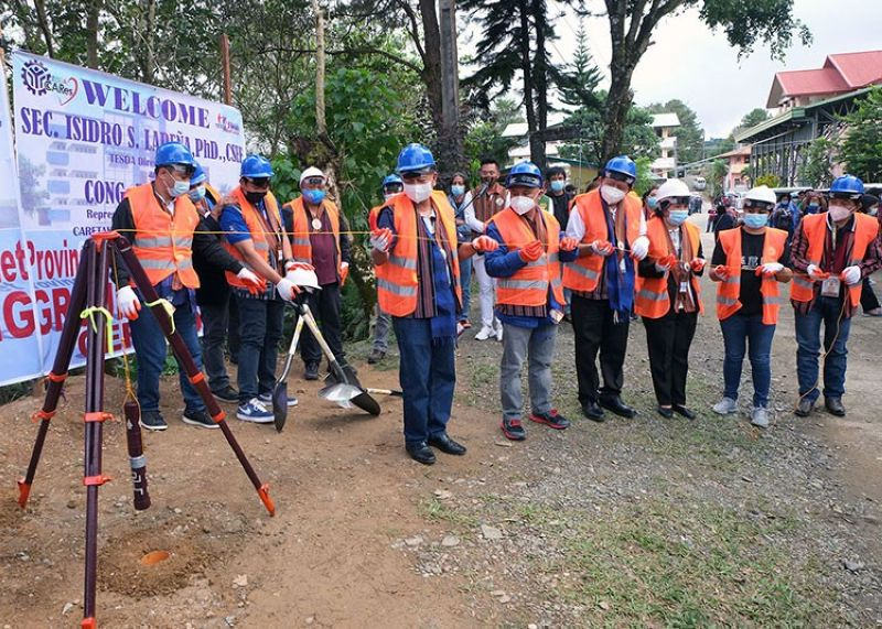 PTC CAPSULE. Technical Education and Skills Development Authority officials, led by Secretary Isidro Lapeña, and Benguet officials led by Representative Eric Go Yap, Governor Melchor Diclas and Kapangan Mayor Manny Fermin, lead the symbolic laying of the time capsule during the groundbreaking of the Benguet Provincial Training Center to be constructed in Kapangan, Benguet on Thursday, February 11, 2021. (Redjie Melvic Cawis)