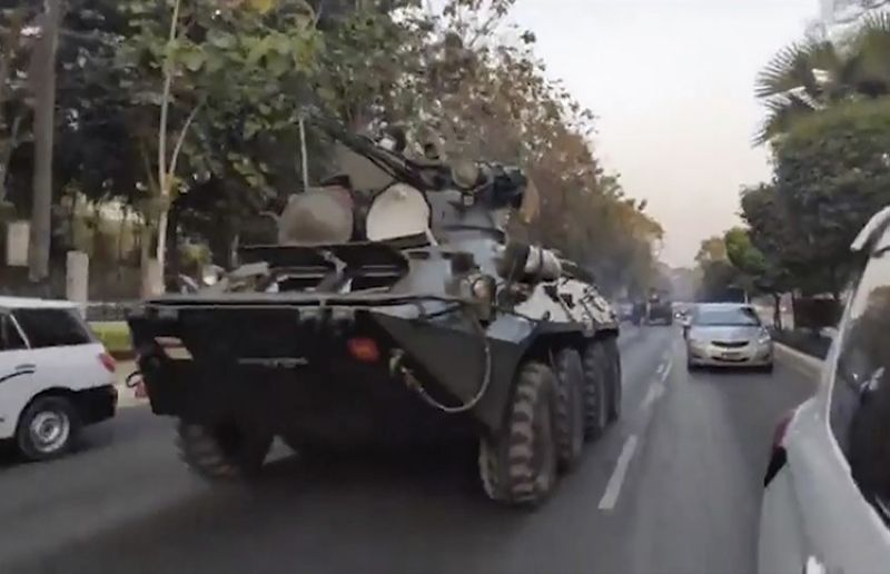 In this image made from video by the Democratic Voice of Burma (DVB), two armored personnel carriers were seen traversing on a road in Yangon, Myanmar, Sunday, Feb. 14, 2021. Sightings of armored personnel carriers in Myanmar's biggest city and an internet shutdown raised political tensions late Sunday, after vast numbers of people around the country flouted orders against demonstrations to protest the military's seizure of power. (AP photo)
