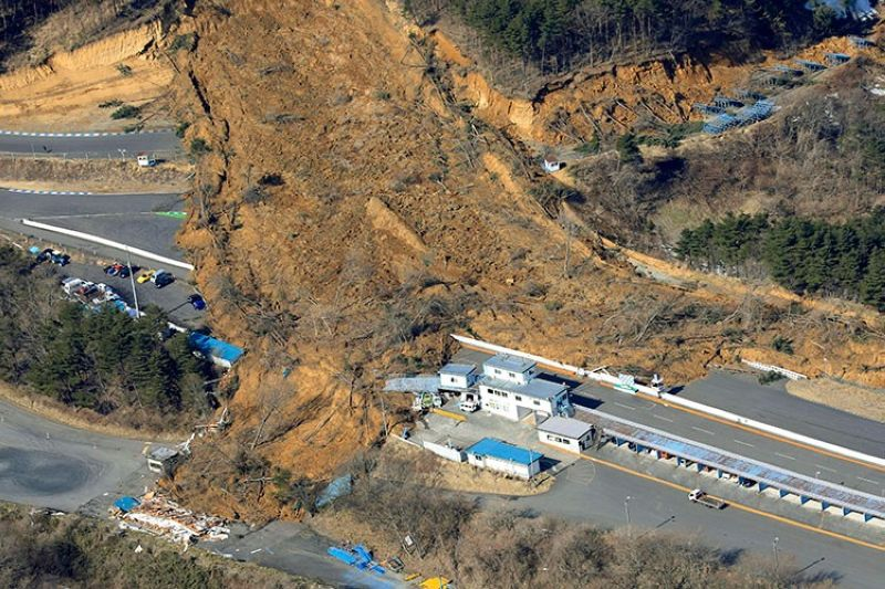 JAPAN. A landslide caused by a strong earthquake covers a circuit course in Nihonmatsu city, Fukushima prefecture, northeastern Japan, Sunday, February 14, 2021. (AP)