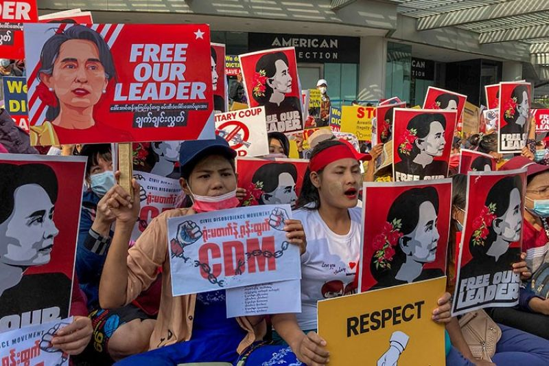 MYANMAR. Demonstrators display images of detained Myanmar leader Aung San Suu Kyi during a protest against the military coup in Yangon, Myanmar, Tuesday, February 16, 2021. (AP)