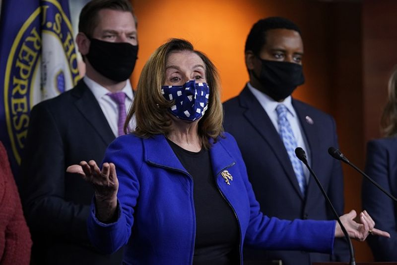 House Speaker Nancy Pelosi of Calif., with impeachment managers Rep. Eric Swalwell, D-Calif., and Rep. Joe Neguse, D-Colo., speaks to members of the media during a news conference on Capitol Hill in Washington, after the U.S. Senate voted not guilty, to acquit former President Donald Trump of inciting riot at U.S. Capitol, ending impeachment trial, Saturday, Feb. 13, 2021. (AP Photo)