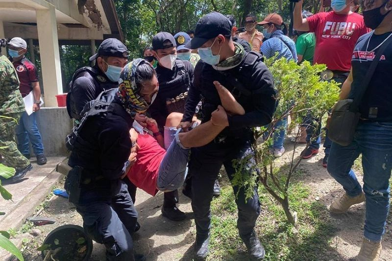 CEBU. Jomar Binag, 21, of Poblacion, Compostela Valley, Davao de Oro, is arrested by members of the Police Regional Office-Central Visayas on February 15, 2021, for his role in the alleged kidnapping and trafficking of 19 minors whom police
