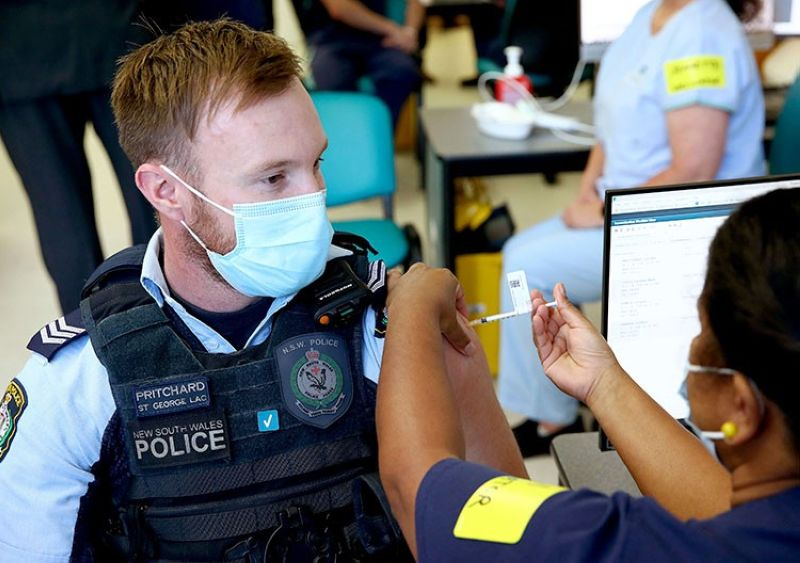 AUSTRALIA. New South Wales Police officer Lachlan Pritchard receives the Pfizer vaccine at the Royal Prince Alfred Hospital Vaccination Hub in Sydney, Australia, Monday, February 22, 2021. (AP)