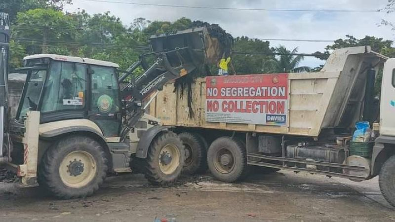 BACOLOD. The Bacolod City Disaster Risk Reduction and Management Office collects more than eight truckloads of garbage at Mambuloc Creek Monday, February 22, 2021. (DRRMO photo)
