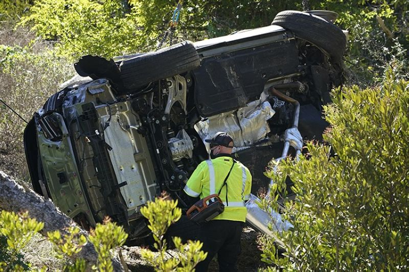 A vehicle rests on its side after a rollover accident involving golfer Tiger Woods Tuesday, Feb. 23, 2021, in Rancho Palos Verdes, Calif., a suburb of Los Angeles. Woods suffered leg injuries in the one-car accident and was undergoing surgery, authorities and his manager said. (AP Photo)