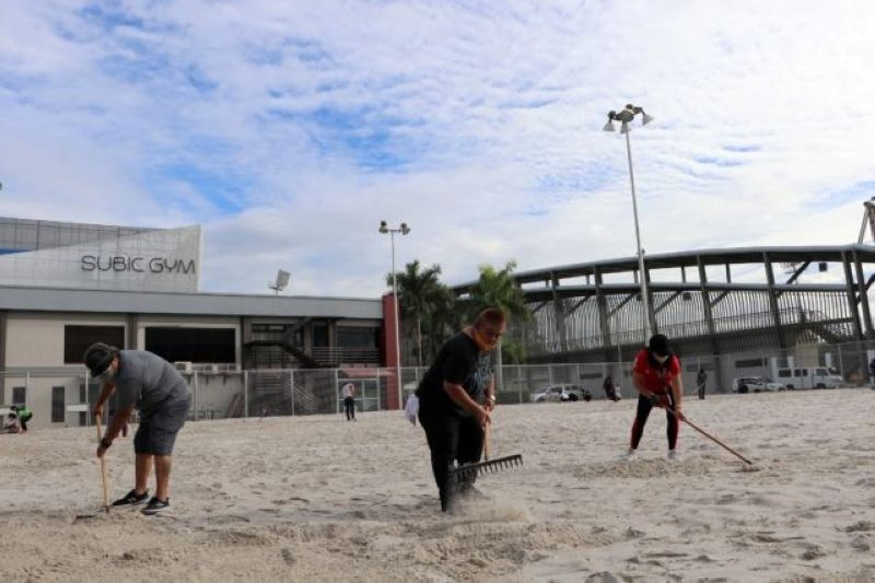 SUBIC FREEPORT SAND COURTS. SBMA workers prepare the sand courts for the start of PSL's 2021 Gatorade-Beach Volleyball Challenge Cup kicking off this February 26. (SBMA photo)