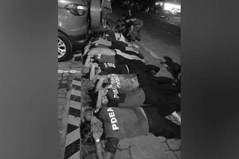 MANILA. Philippine Drug Enforcement Agency (PDEA) lie face down with their hands behind their heads after a shootout with the police on Feb. 24, 2021. (Contributed/PNP-PIO)