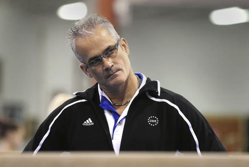 John Geddert watches his students during practice in December 2011. Geddert, a former U.S. Olympics gymnastics coach with ties to disgraced sports doctor Larry Nassar, killed himself Thursday, Feb. 25, 2021, hours after being charged with turning his Michigan gym into a hub of human trafficking by coercing girls to train and then abusing them. Geddert faced 24 charges that could have carried years in prison had he been convicted. (AP)
