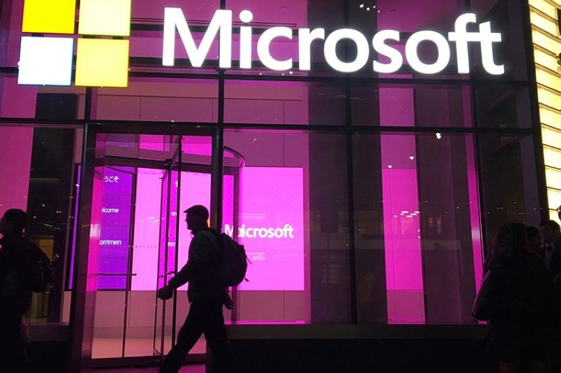 In this Nov. 10, 2016, file photo, people walk past a Microsoft office in New York. China-based government hackers have exploited a bug in Microsoft's email server software to target U.S. organizations, the company said Tuesday, March 2, 2021. (AP file photo)