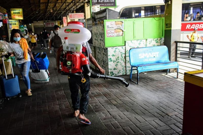 DISINFECTION. A worker from the City Government of Mabalacat disinfects common areas at the city bus terminal for the safety of commuters after the IATF eased travel restrictions recently. (Mabalacat City Facebook)