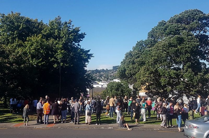 People gather on high ground in Whangarei, New Zealand, as a tsunami warning is issued Friday, March 5, 2021. A powerful magnitude 8.1 earthquake struck in the ocean off the coast of New Zealand prompting thousands of people to evacuate and triggering tsunami warnings across the South Pacific. (AP)