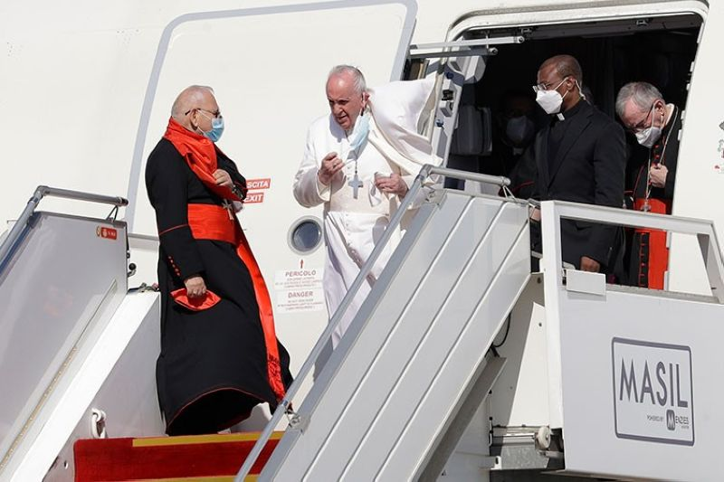 IRAQ. Pope Francis walks down the steps of an airplane as he arrives at Baghdad international airport, Iraq, Friday, March 5, 2021. (AP)