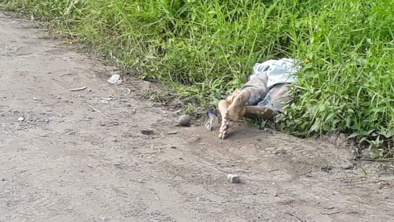 VICTORIAS. A dead man believed to have been shot and dumped in the area was found tied up in Canetown Subdivision, Victorias City Sunday. (Victorias City police photo)