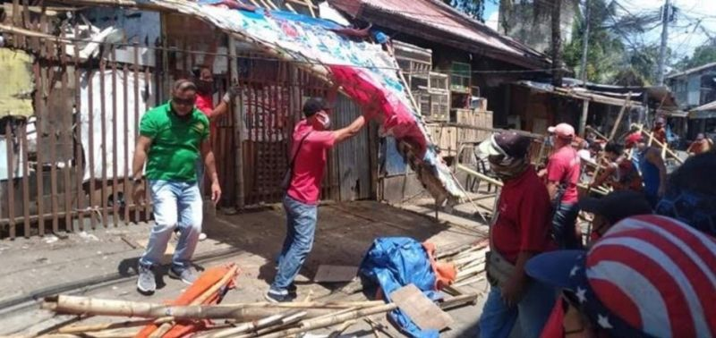 BACOLOD. The Bacolod City Legal Office-Enforcement Team and Market Coordinating and Monitoring Task Force demolish the illegal structures at Bacolod Vendor's Plaza in Barangay 12, Bacolod City Tuesday, March 9, 2021. (Ernesto Pineda)