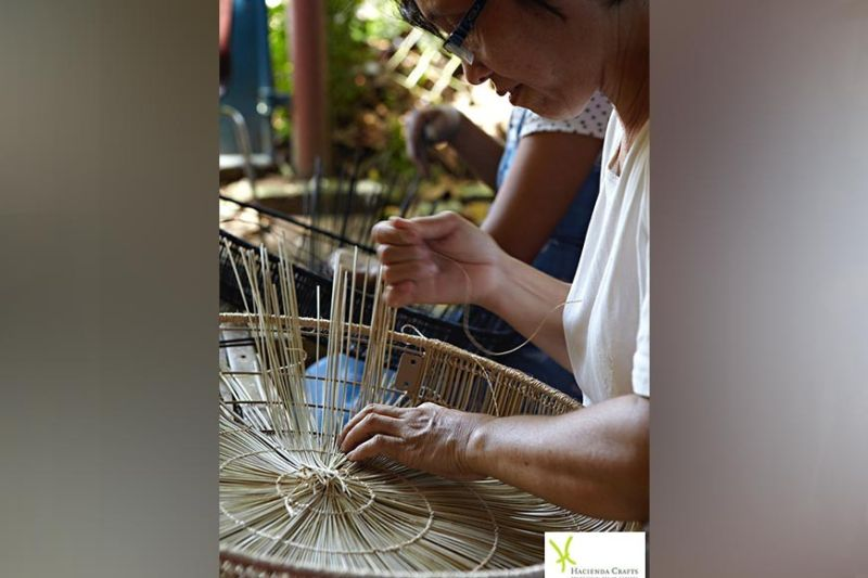 NEGROS OCCIDENTAL. One of the women weavers of Hacienda Crafts Company, which is among the seven micro, small and medium enterprises from Negros Occidental being featured in the ongoing Asean International Furniture and Furnishings Show 2021.(Contributed photo)