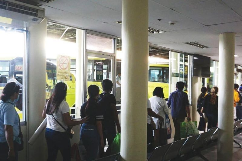 Automated fare system at South Bus Terminal in effect on April 15. (File photo)