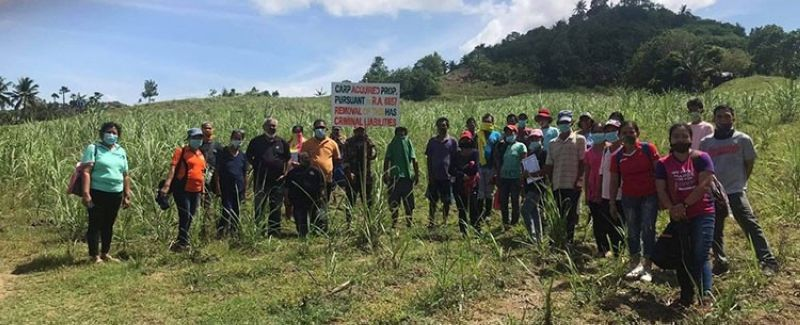 NEGROS. Seventy-six farmers in Toboso receive 45 hectares of land during the distribution and installation rites in Barangay Salamanca in the northern Negros Occidental town recently. (Contributed Photo)