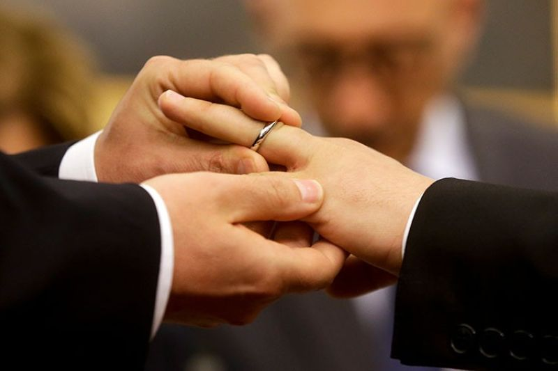 ITALY. In this May 21, 2015 file photo, Mauro Cioffari (left) puts a wedding ring on his partner Davide Conti's finger as their civil union is being registered by a municipality officer during a ceremony in Rome's Campidoglio Capitol Hill. (AP)