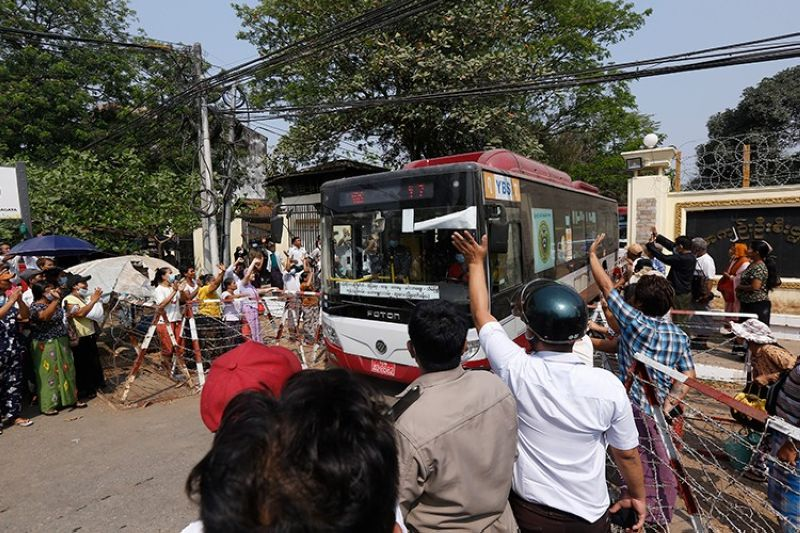 MYANMAR. A bus with arrested protesters is driven out of Insein prison and headed to an undisclosed location Wednesday, March 24, 2021, in Yangon, Myanmar. (AP)