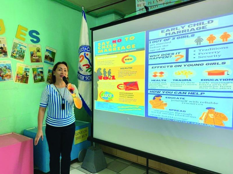 """CAMPAIGN. The launching of the advocacy on """"Ending Child Marriage"""" by teachers and staff, led by ChildLink Learning Center executive director Ma. Theresa Tio."""