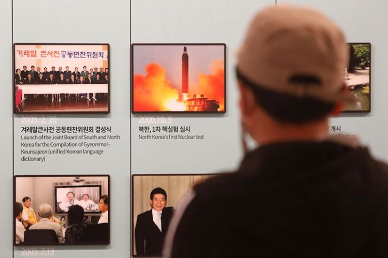 KOREA. A photo showing North Korea's missile launch is displayed at the Unification Observation Post in Paju, near the border with North Korea and South Korea, Wednesday, March 24, 2021. (AP)