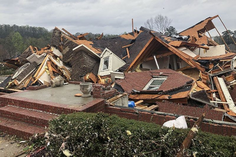 Damage is seen to a home after a tornado passed through the Eagle Point subdivision, Thursday, March 25, 2021, near Birmingham, Ala. (AP Photo)