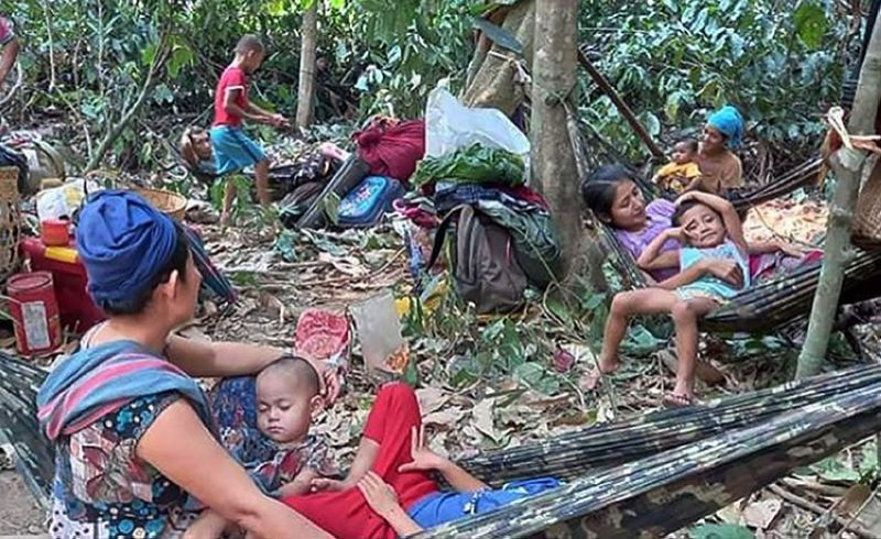 In this photo released by the Free Burma Rangers, Karen villagers gather in the forests as they hide from military airstrikes in the Deh Bu Noh area of the Papun district, north Karen state, Myanmar, Sunday, March 28, 2021. Thai authorities along its northwestern border braced themselves, Monday, for a possible influx of more ethnic Karen villagers fleeing the fear of renewed air strikes from the Myanmar military. (AP)