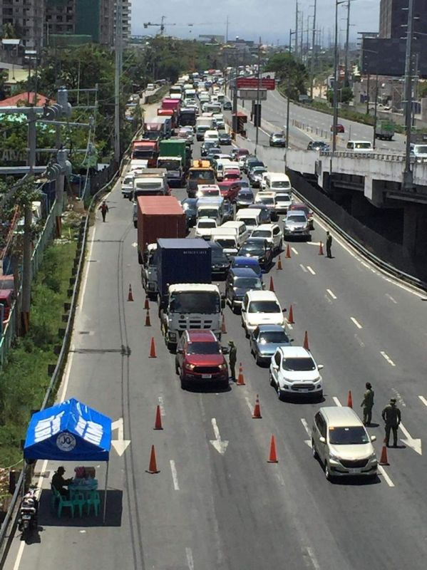 MANILA. Traffic builds up along Coastal Road leading to Roxas Boulevard due to a quarantine checkpoint on March 29, 2021. (Third Anne Malonzo)