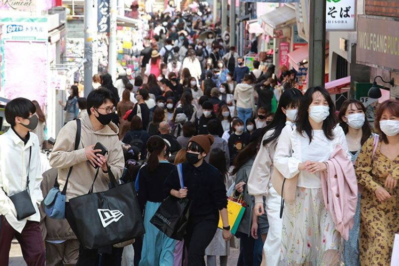 JAPAN. People wearing face masks to protect against the spread of the coronavirus walk on a street in Tokyo, Wednesday, March 31, 2021. (AP)