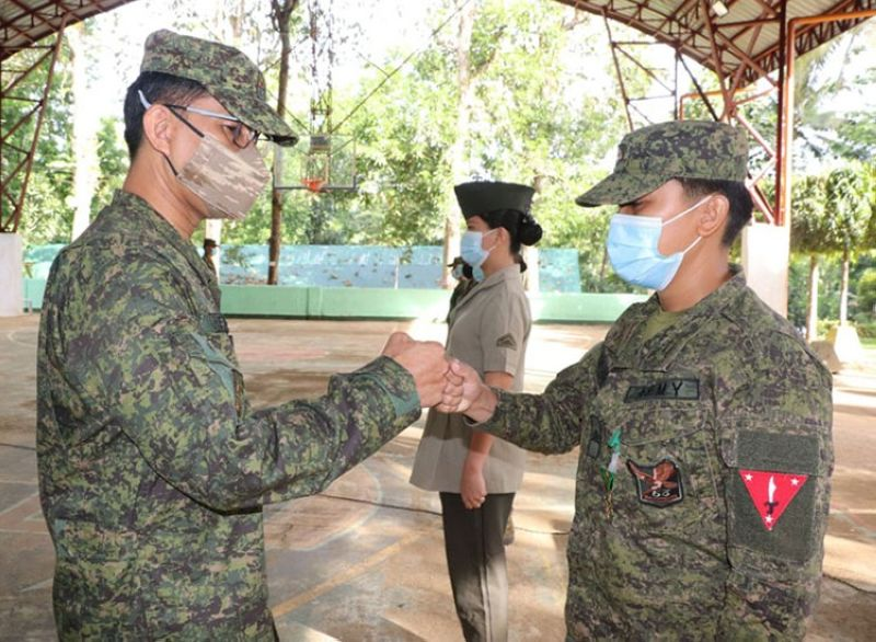 ZAMBOANGA. The Army's 53rd Infantry Battalion (IB) awards Military Merit Medal to seven women troops for exemplary performance to duty as soldiers. A photo handout shows Lieutenant Colonel Jo-ar Herrera, 53IB commander (left) congratulating one of the seven awardees in a ceremony at Camp Sabido, Guipos, Zamboanga del Sur. (SunStar Zamboanga)