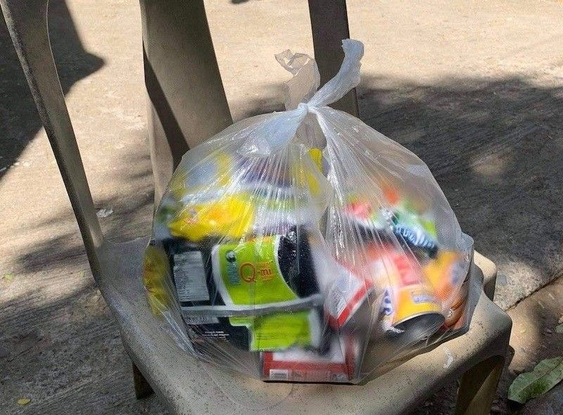 BULACAN. The local government unit of Cacarong, Pandi, Bulacan distributed on Tuesday, March 30, 2021, a bag of groceries consisting of three kilograms of rice, four packs of noodles, four cans of meat loaf, two cans of corned beef and mongo beans. (Contributed Photo)