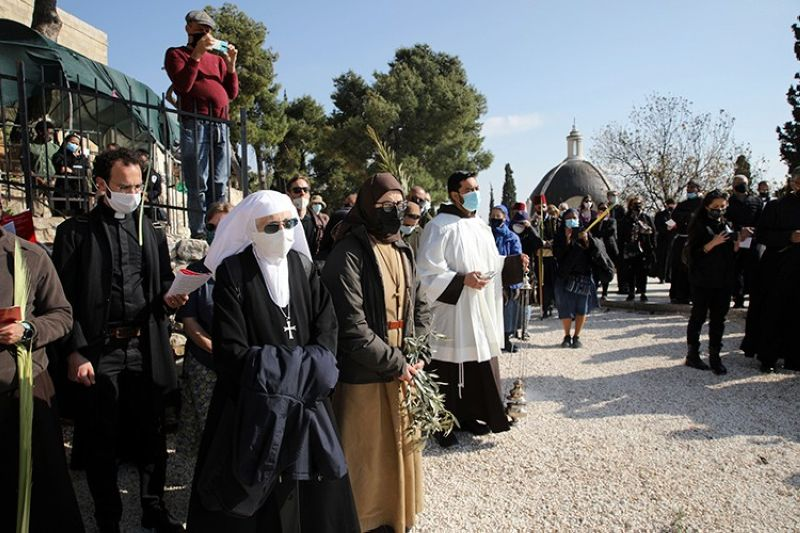 JERUSALEM. Christian worshippers mark Palm Sunday on the Mount of Olives in Jerusalem, Sunday, March 28, 2021. (AP)