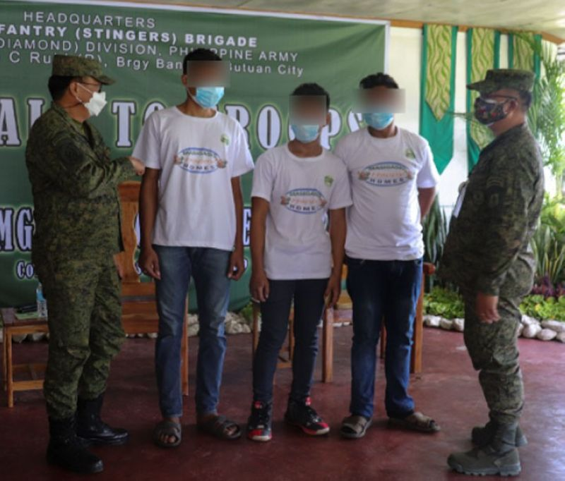 ZAMBOANGA. In defiance to the organiztion, three members of the New People Army (NPA) surrender to government authorities on March 29 in Butuan City, Agusan del Norte, while the NPA marks it 45th founding anniversary. A photo handout shows three NPA surrenderers together with Eastmincom officials headed by Major General Greg Almerol. (SunStar Zamboanga)
