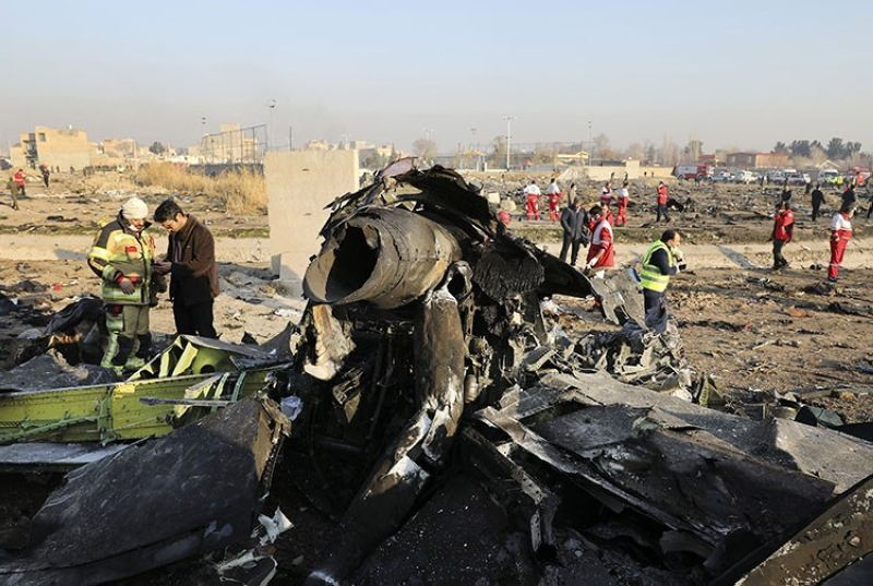 In this Jan. 8, 2020, file photo, debris at the scene where a Ukrainian plane crashed in Shahedshahr southwest of the capital Tehran, Iran. Iranian media are quoting the outgoing military prosecutor of Tehran as saying that 10 officials have been indicted for the 2020 shootdown of a Ukrainian passenger plane. (AP file photo)