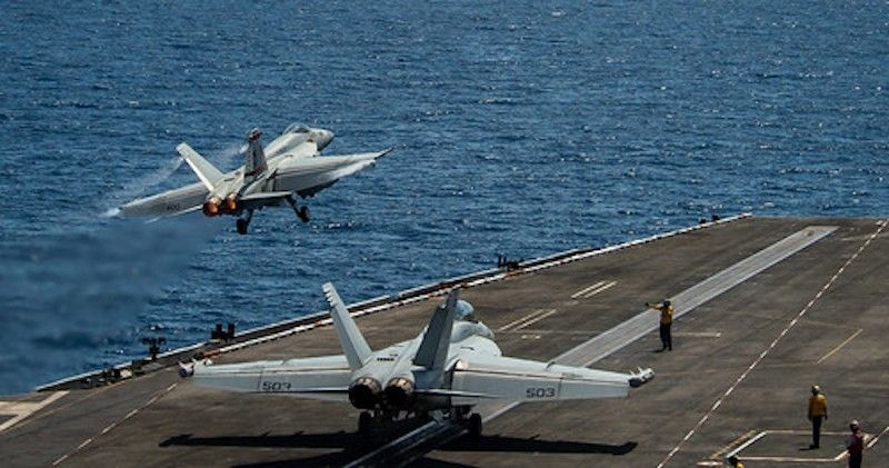 SOUTH CHINA SEA. An F/A-18E Super Hornet assigned to Strike Fighter Squadron 87 launches from USS Theodore Roosevelt during flight operations in the South China Sea, April 6. (US Navy)