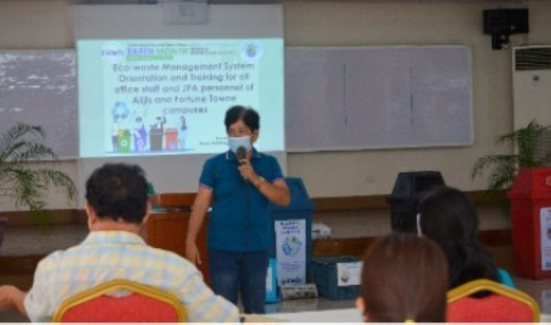 TALISAY. Janet P. Estimar, team leader of the Eco-waste Management Team, gives a lecture presentation. (Contributed photo)