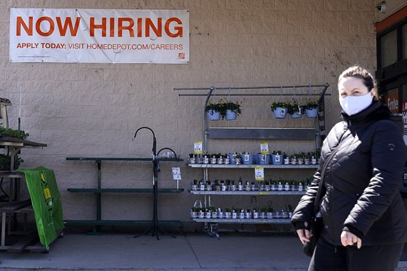 A hiring sign is seen outside home improvement store in Mount Prospect, Ill., Friday, April 2, 2021.  The pace of job openings reached the highest level on record in February, a harbinger of healthy hiring and a hopeful sign for those looking for work.  (AP Photo)