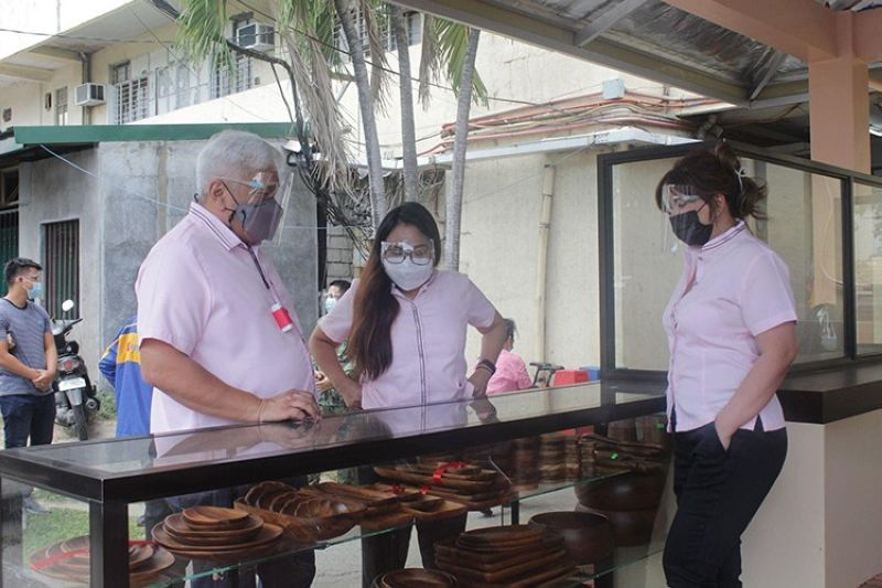 PAMPANGA. Mayor Carmelo Lazatin Jr., with Executive Assistant IV Reina Manuel and Angeles City Economic Development and Investment Promotions Office head Irish Bonus-Llego inspect the Gawang Angeleño products in one of the One Town One Product (Otop) kiosks inside the Angeles City Hall compound. (Contributed photo)
