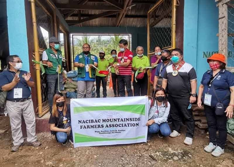 ZAMBOANGA. The Department of Agriculture (DA) distributed last week some P1.7 million worth of livelihood assistance to the Nacaibac Farmers Mountainside Farmers Association (NMFA). A photo handout shows DA Regional Executive Director Rad Donn Cedeño (2nd from left in green vest) leading the inauguration of a corn mill given to the NMFA. (SunStar Zamboanga)
