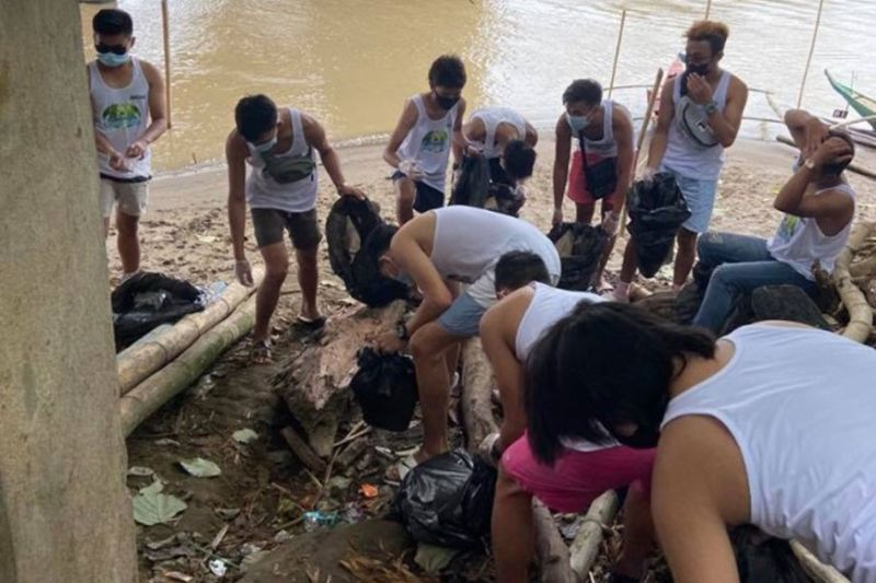 NEGROS. The models clean a portion of Ilog river in Malabong. (Contributed photo)
