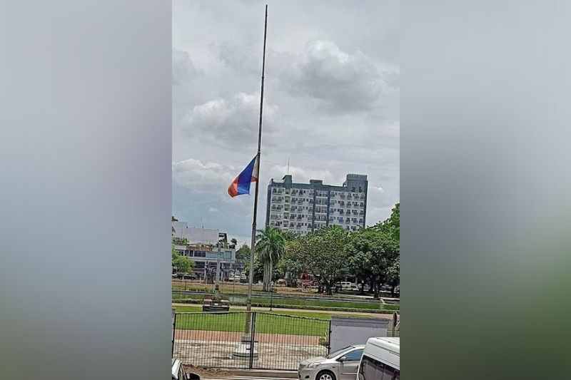 MOURNING. The national flag at the Provincial Capitol Lagoon and Park flies at half-mast as the Provincial Government mourns the death of Provincial Consultant on Hospital Operations Mariano Antonio