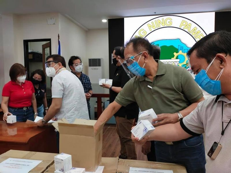 PITCHING IN. Governor Dennis Pineda and board members take a look at the vitamins donated by a business entity to help in Pampanga's drive against Covid-19. (Pampanga PIO)