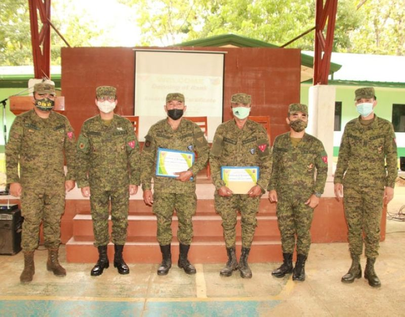 ZAMBOANGA. The 53rd Infantry Battalion headed by Lieutenant Colonel Jo-ar Herrera (2nd from left) awards certificate of recognition to two members of the militia force, Pedro Maloloy-on Jr. and Rustom Aclo (holding certificates), for dedication to duty. Photo shows the two awardee militiamen together with Herrera and other 53IB officials in a photo session at Camp Major David Sabido in Guipos, Zamboanga del Sur. (SunStar Zamboanga)