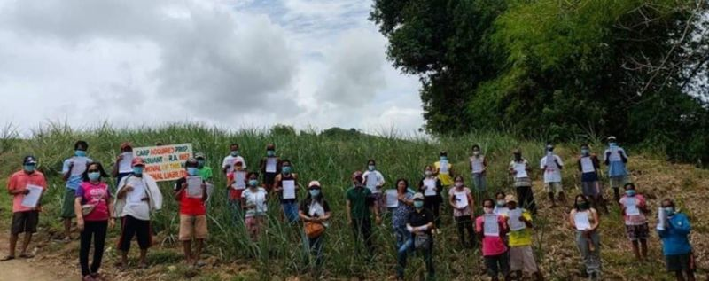 TOBOSO. Forty-seven agrarian reform beneficiaries in Toboso town receive their certificates of land ownership award covering about 21.8 hectares in distribution and installation rites held at Barangay Salamanca on Tuesday. (Contributed photo)