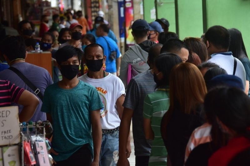 Cebu City to continue to fine people  caught without face masks outdoors. (File photo)