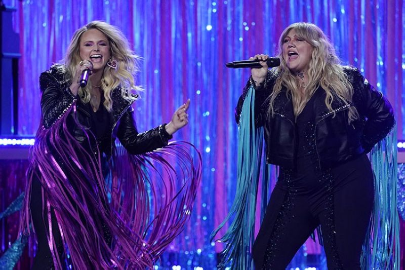 Miranda Lambert, left, and Elle King perform at the 56th annual Academy of Country Music Awards on Saturday, April 17, 2021, at the Grand Ole Opry in Nashville, Tenn. The awards show airs on April 18 with both live and prerecorded segments. (AP Photo)