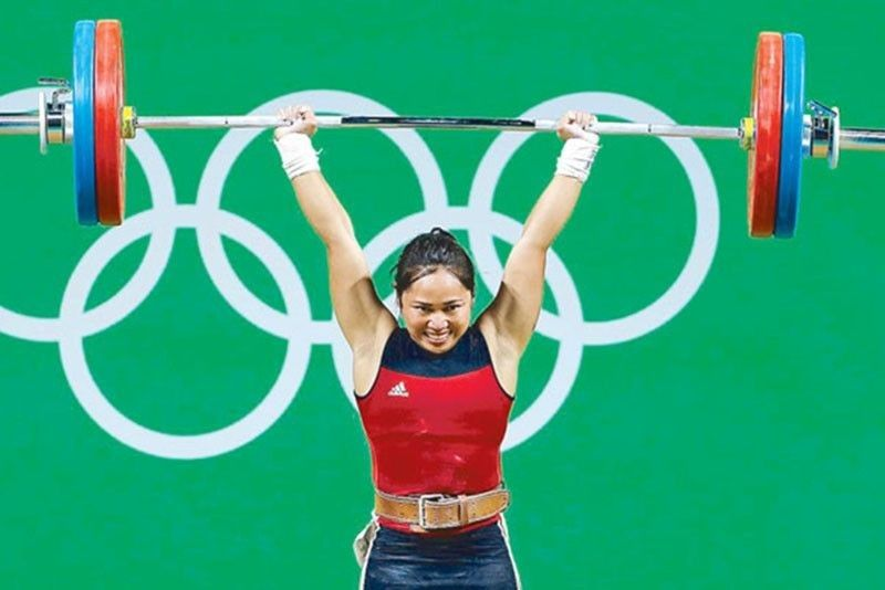 4TH OLYMPICS. Hidilyn Diaz secures a spot in the Tokyo Olympics after competing in the Asian Weightlifting Championships in Tashkent, Uzbekistan on April 18. She will be seeing action in her fourth Olympics, making her the most experienced Filipino athlete in the quadrennial games. (AP)