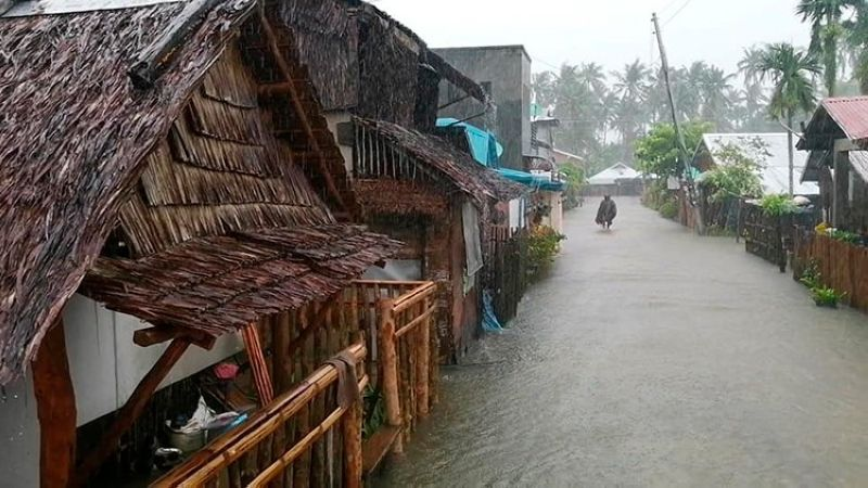 EASTERN SAMAR. In this photo provided by the San Policarpo Fire Station, a man wades through floodwater caused by Typhoon Bising (Surigae) in the municipality of San Policarpio, Eastern Samar on Sunday, April 18, 2021. (AP)