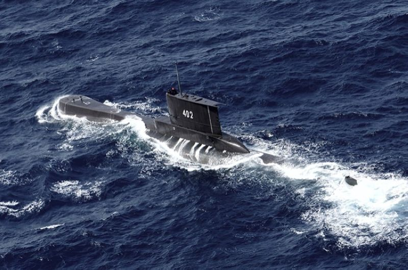 Indonesian Navy submarine KRI Nanggala sails in the waters off Tuban, East Java, Indonesia, as seen in this aerial photo taken from Indonesian Navy helicopter of 400 Air Squadron, in this Monday, Oct. 6, 2014 photo. Indonesia's navy is searching for the submarine that went missing north of the resort island of Bali with a number of people on board, the military said Wednesday. (AP Photo)
